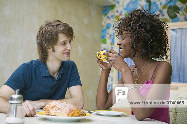 Young couple eating breakfast  Germany
