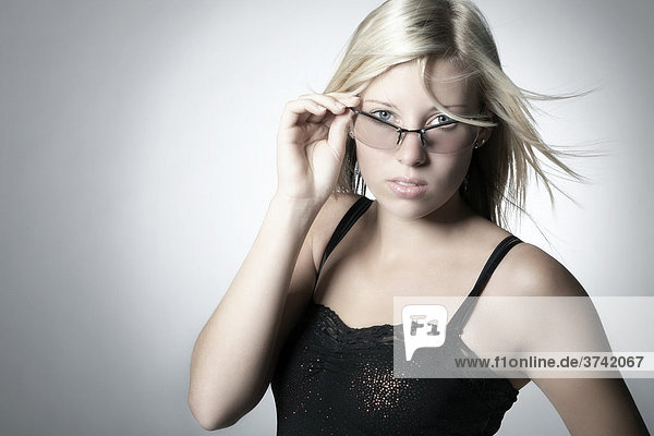 Portrait of a young blond woman wearing sunglasses