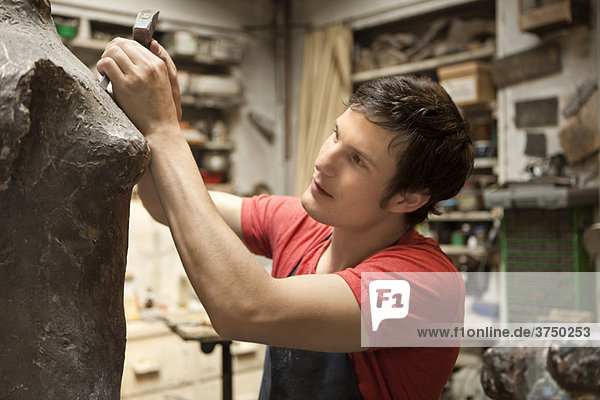 Artist working on sculpture