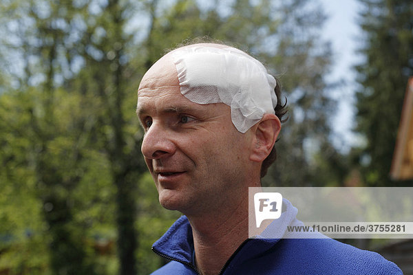 Portrait of a man  45  with an adhesive bandage on his head  Geretsried  Bavaria  Germany  Europe