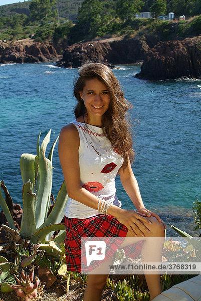 Young woman standing  EstÈrel Range on the Mediterranean  ThÈoule-sur-Mer  France  Europe