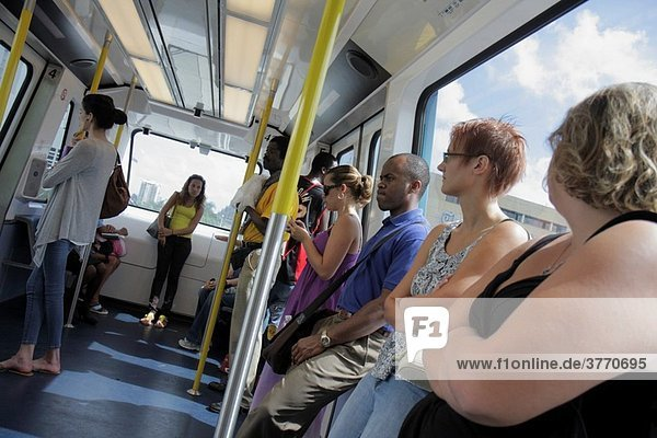 Florida  Miami  Omni Loop  Metromover  public transportation  mass transit  automated people-mover  passenger  Black  man  woman  standing  rider