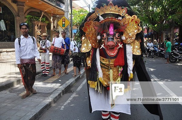 Legian (Bali  Indonesia): a group of youngsters collecting offers from shops during a Hindu festival