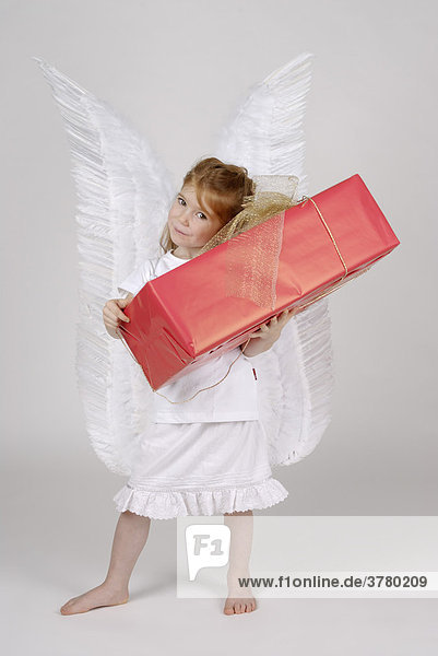 Little christmas angel with a christmas present