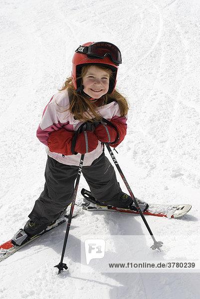 Girl is skiing with helmet skies