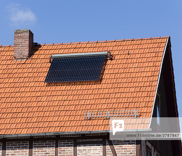 An old house with modern technology on its roof