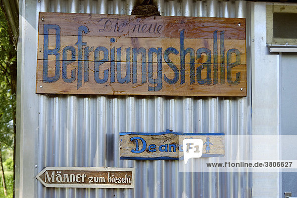 Signs Befreiungshalle  Liberation Hall  toilets  beer garden near the ferry across the river Danube  Eining  district of Kelheim  Lower Bavaria  Germany  Europe
