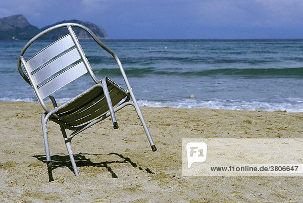 Beatch with chair waiting for summer