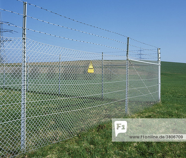 Fence with barb wire and high voltage wire