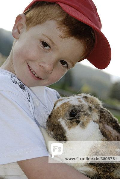 Child with his pet rabbit