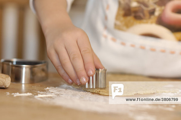 Child baking cookies for christmas
