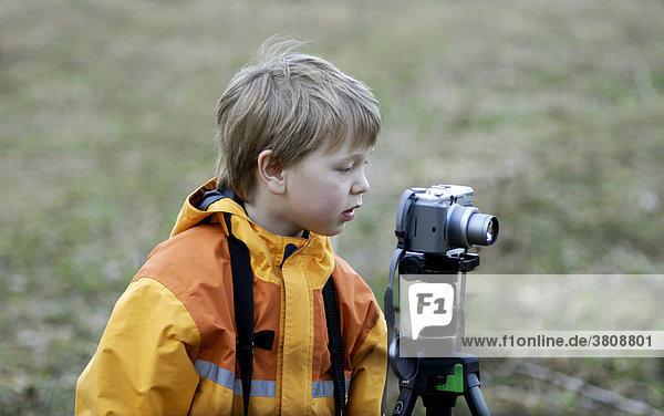 Boy taking photos with a digital camera