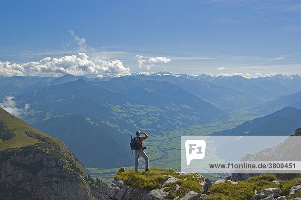 Hiker on Rofan mountains with view over valley of Inn to Zillertal  Tyrol  Austria