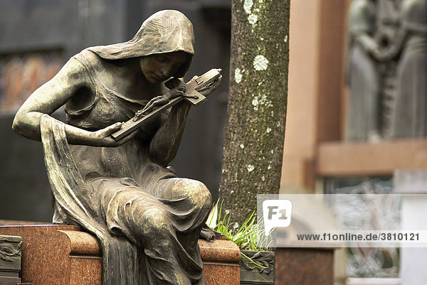 """Tombs and Angel with Crucifix at the graveyard ConceiÁ""""o in S""""o Paulo  Brazil"""