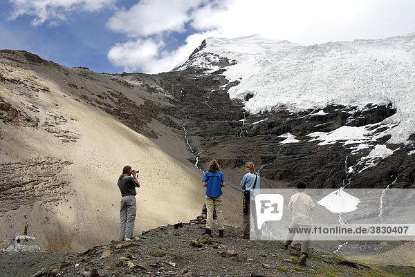 Tourists take pictures of the glacier at Karo-La Pass Tibet China