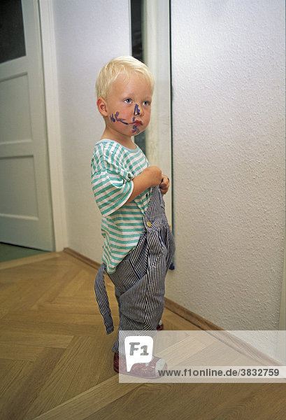 Two-year-old boy with painted face MR