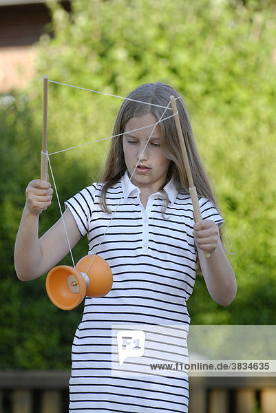 Girl plays with diabolo