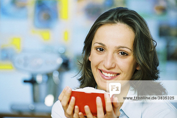 Young woman with a cup of milk coffee