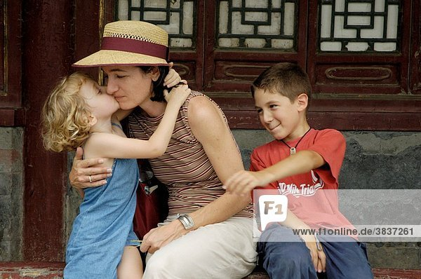 China beijing behai park a european woman with her two children resting