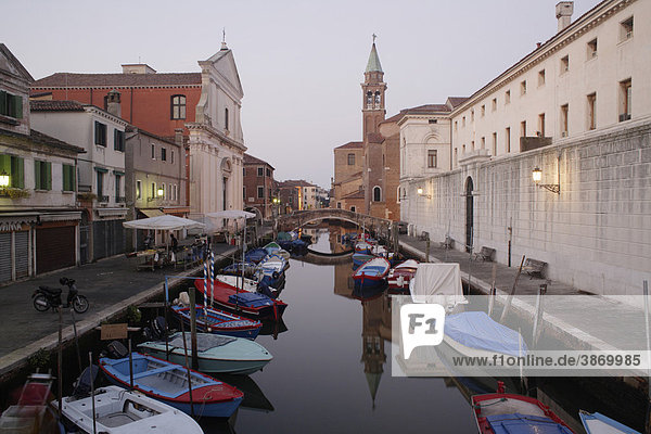 ambiance  ambient  architecture  atmosphere  atmospheric  belief  boat  Boats  boats  bodies  body  building  buildings  canal  Canale  canals  Chioggia  Christian  Christianity  church  churches  churchtower  churchtowers  cities  city  creed  dusk  Europe  European  evening  exterior  exteriors  facade  facades  faith  filled  front  fronts  full  house  houses  italian  Italy  Lagoon  mood  mood-filled  moods  nobody  of  on  outdoor  photo  photos  Religion  religious  shot  shots  South  Southern  steeple  steeples  the  tower  towers  town  towns  twilight  Vena  Venetia  venetian  Veneto  water  waters