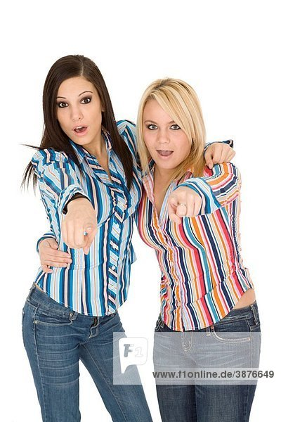 Female Caucasian friends acting silly on white background