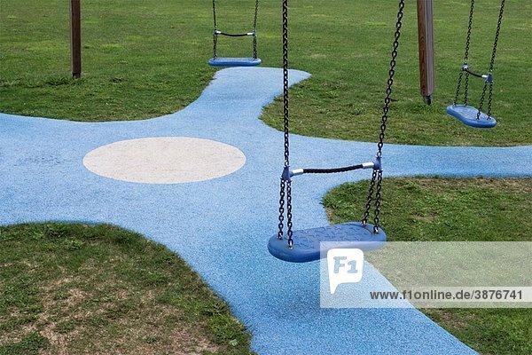 swings in playground swings in playground
