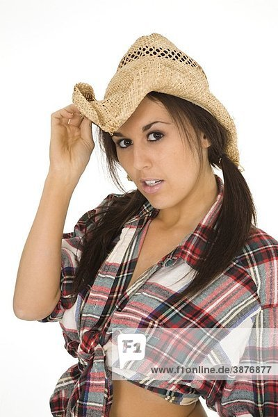 Very sexy Caucasian woman dresses as a cowgirl standing on white background