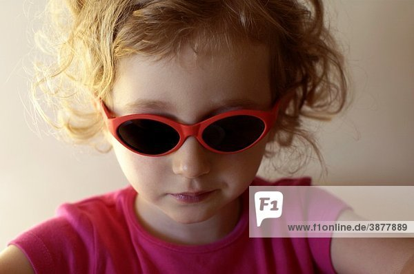 Little girl wearing sunglasses