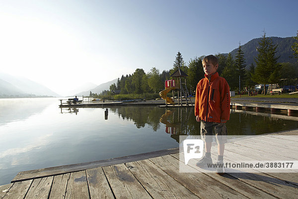 Child in the morning  Weissensee Lake  Carinthia  Austria  Europe