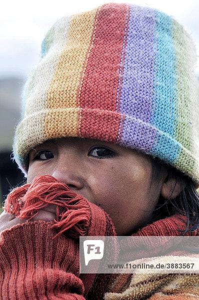 Girl wearing a colorful hat  Bolivian Altiplano highlands  Departamento Oruro  Bolivia  South America