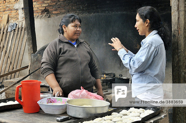 Aid worker advising a baker  San Ignacio  Chiquitania  Santa Cruz Department  Bolivia  South America