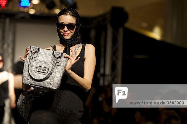 Female model in a fashion show in the Emmencenter shopping center in Emmenbruecke  Lucerne  Switzerland