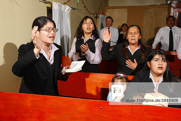 Women singing during church service  mining town of Lota  Chile  South America