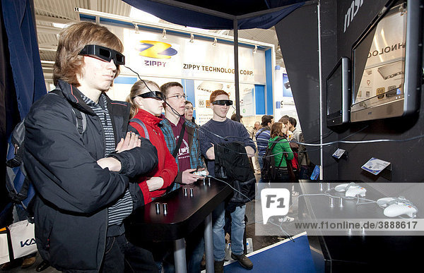 Visitors watching a movie with 3D technology  Internationale Computermesse CEBIT international computer fair  Hannover  Lower Saxony  Germany  Europe