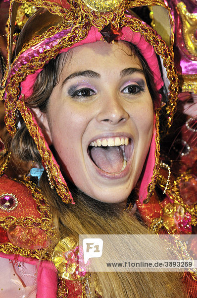 Unidos da Tijuca samba school  a young woman in costume laughing happily  Carnaval 2010  Sambodromo  Rio de Janeiro  Brazil  South America