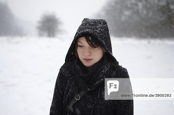 Young woman in a park in the snow