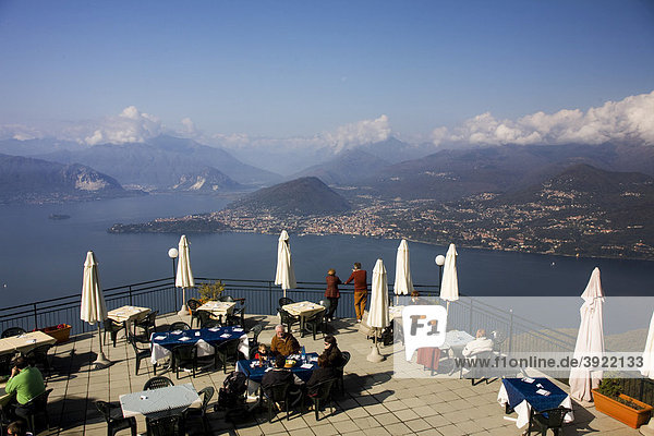 Restaurant with panoramic view over lake Maggiore and Alps from Sasso del Ferro mount  Laveno  Varese  Italy  Europe