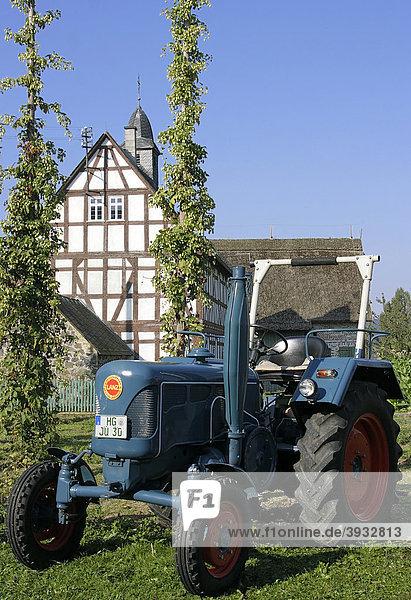 Lanz Traktor vor historischen Fachwerkhäusern im Hessenpark  Neu-Anspach  Hessen  Deutschland  Europa