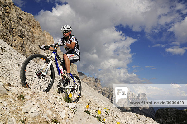 Mountain bike pro Roland Stauder in front of Patern Pass  Alta Pusteria  Dolomites  South Tyrol  Italy  Europe