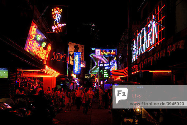 Night scene  neon signs  sex  red light district of Soi Cowboy  Sukhumvit  Bangkok  Thailand  Southeast Asia  Asia