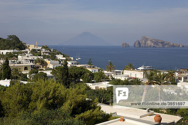 View on the Panarea island  in the middle back the Stromboli volcano  Aeolian Islands  Sicily  Italy  Europe