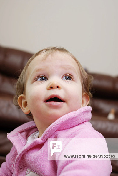 Portrait of baby girl looking up