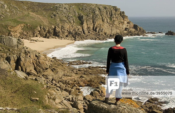 Woman looking at beach  hiking  coast  sea  Porth Chapel Beach  Cornwall  southern coast  South England  Great Britain