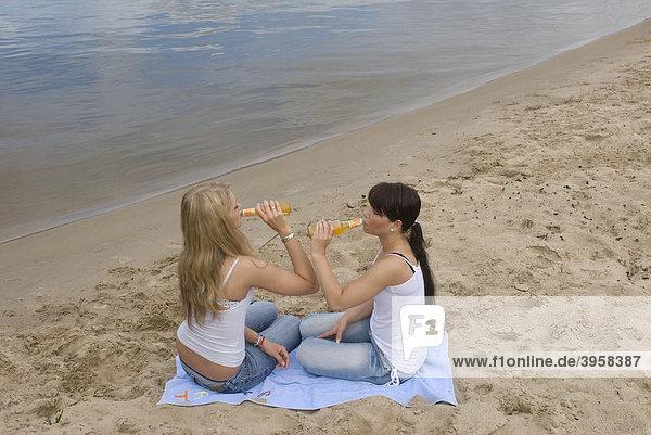 Girls  teenagers  alcohol  drinking  leisure  beach