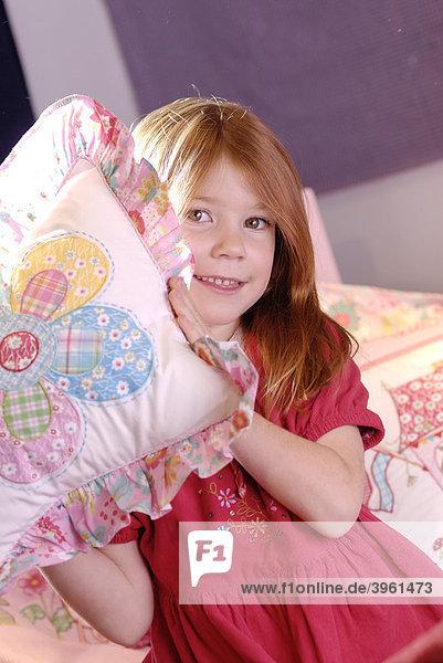 Little girl throwing a pillow  pillow fight