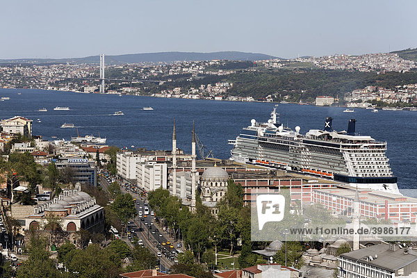 View over the rooftops of Galatasaray on the Bosporus  a large cruise ship on the quay of Tophane  Istanbul  Turkey