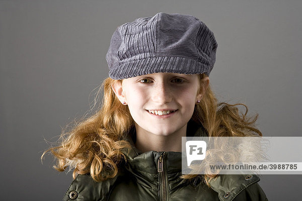 Red-haired girl wearing a cap and a parka