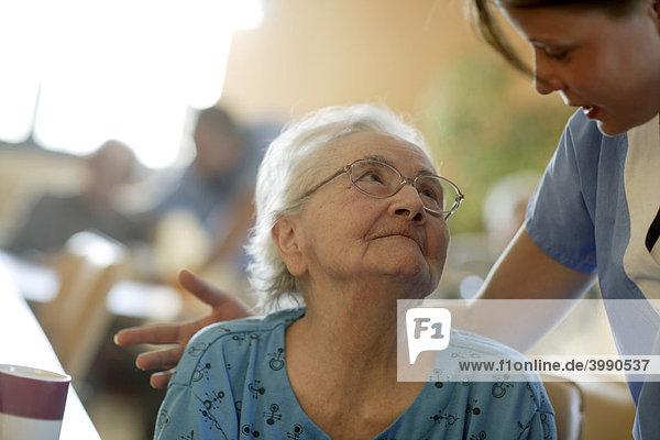 Nursing home  elderly woman with a nurse