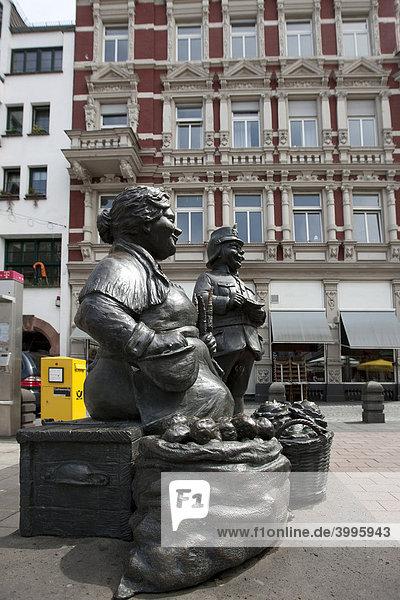 Maatfrau and Schutzmann Sculptures  made of bronze  in Muenzstrasse Street  Koblenz  Rhineland-Palatinate  Germany  Europe