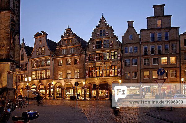 Old  gabled houses with arcades  evening illumination  Muenster  Westphalia  Germany  Europe